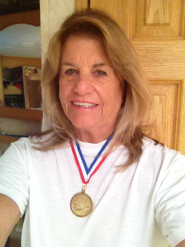 Cathy Behrens/Special to the Pahrump Valley Times Pahrump resident Cathy Behrens poses with the gold medal she won in the 75-79 50-yard freestyle at the Nevada Senior Games.