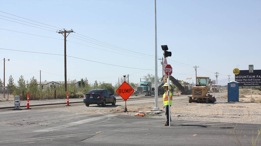 Robin Hebrock/Pahrump Valley Times Flaggers are shown along Homestead Road in Pahrump earlier this year. Flaggers are there not only to protect road construction workers but also to protect driver ...