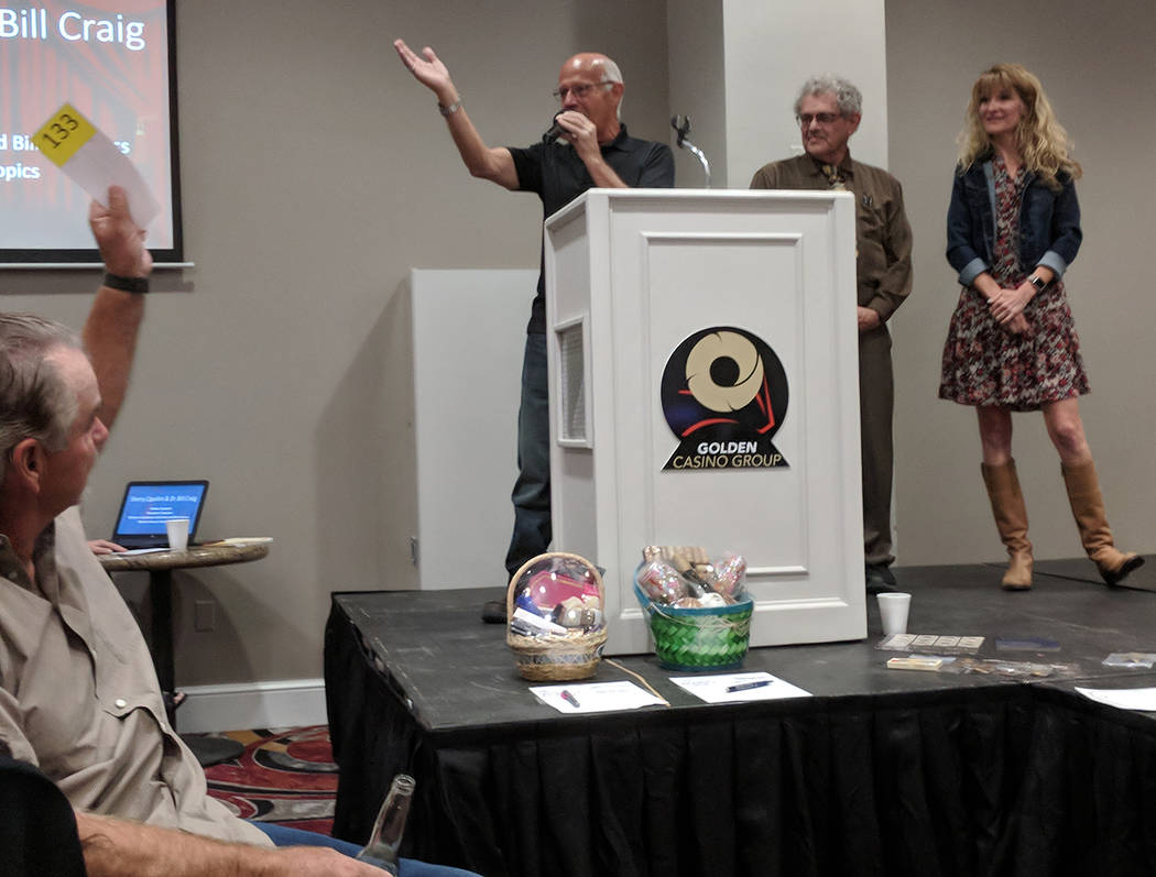 Jolina Mackool/Special to the Pahrump Valley Times An auction participant raises his bidders card while professional auctioneer Ski Censke, on stage at left, calls for bids on local celebrities Sh ...