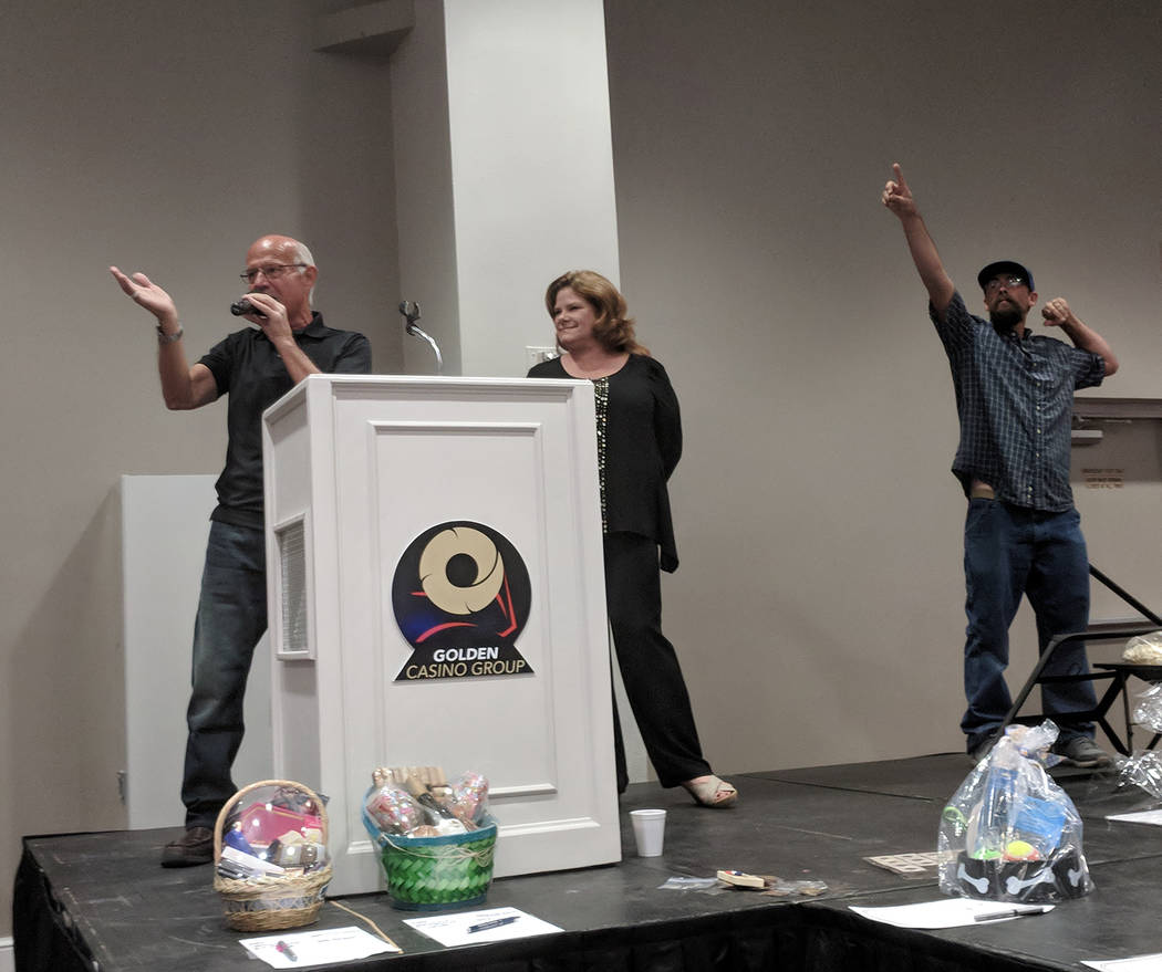 Jolina Mackool/Special to the Pahrump Valley Times Ski Censke was aided in his auctioneering duties by Ron Gipson. The two are pictured auctioning off Deanna O'Donnell, reporter and anchor for Cha ...