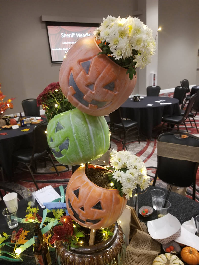 """David Jacobs/Pahrump Valley Times Table decor was a big to-do at the Nye County Celebrity Auction, with the """"best decorated table"""" award up for grabs that evening."""