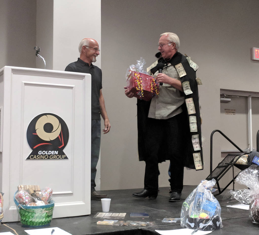 Jolina Mackool/Special to the Pahrump Valley Times Pahrump area general contractor Tom Laskowski, right, came to the celebrity auction decked out in a cape covered in cash and played it up to the ...