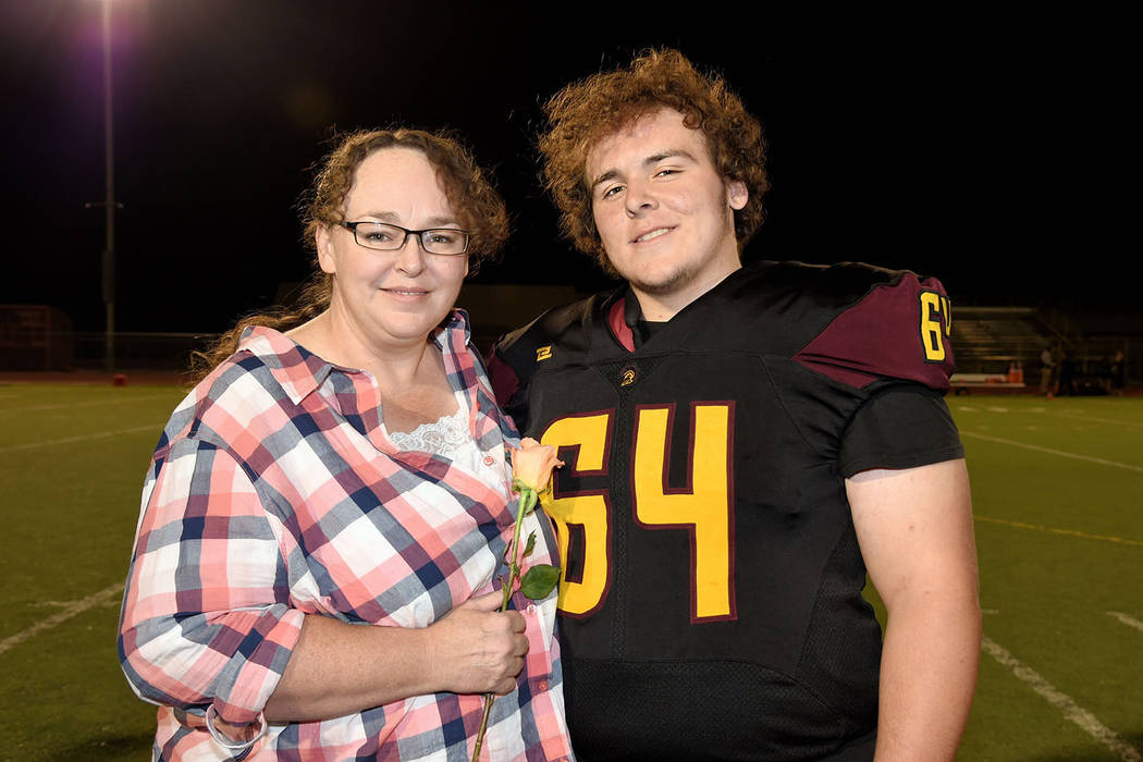 Peter Davis/Special to the Pahrump Valley Times Senior center/defensive tackle Jakob Landis with his mother Oct. 12 at Trojan Field before Pahrump Valley routed Western 66-0 on Senior Night.