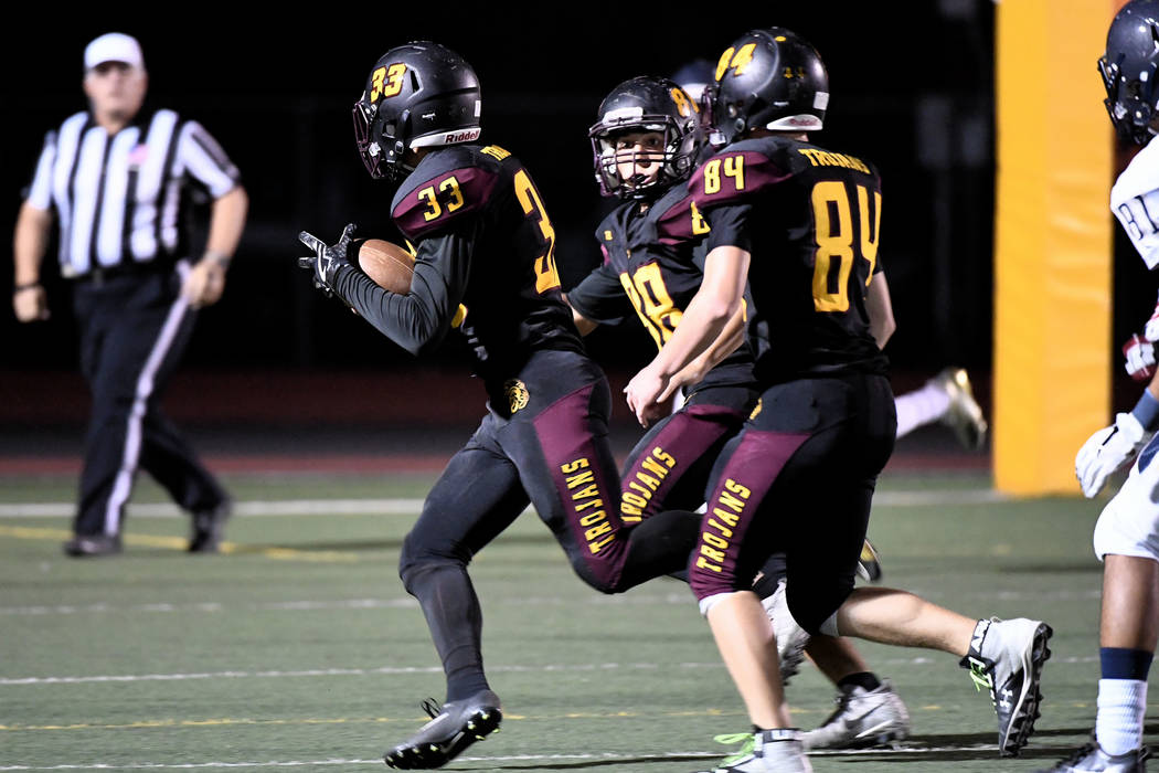 Peter Davis/Special to the Pahrump Valley Times Jalen Denton returns a blocked punt for a touchdown as Andrew Avena (84) and Antonio Margiotta (88) look for potential tacklers to block against Che ...