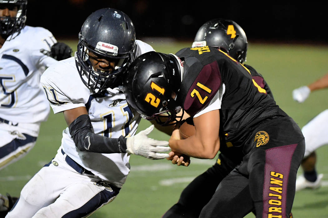 Peter Davis/Special to the Pahrump Valley Times Junior Kenny Delker tries to bull his way for extra yardage while Joshua Washington of Cheyenne tries to bring him down during Pahrump Valley's 38-1 ...