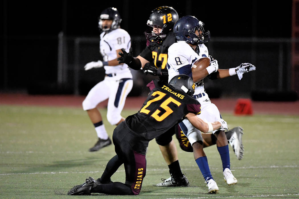 Peter Davis/Special to the Pahrump Valley Times Pahrump Valley senior Willie Lucas wraps up Cheyenne's Tayjon Bullock during the Trojans' Sept. 28 victory over the Desert Shields in Pahrump.