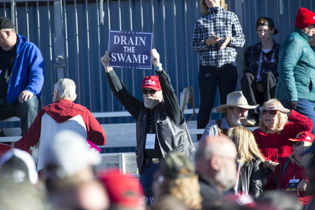 A supporter of President Donald Trump waves his sign during a Make America Great Again Rally in Elko, Nev., on Saturday, Oct. 20, 2018. Richard Brian Las Vegas Review-Journal @vegasphotograph