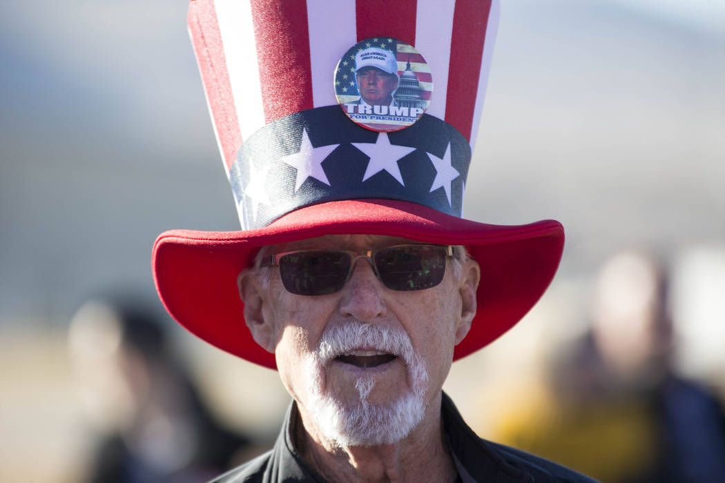 Fred McBryde of Minden, Nev., waits for President Donald Trump to arrive during a Make America Great Again Rally in Elko, Nev., on Saturday, Oct. 20, 2018. Richard Brian Las Vegas Review-Journal @ ...