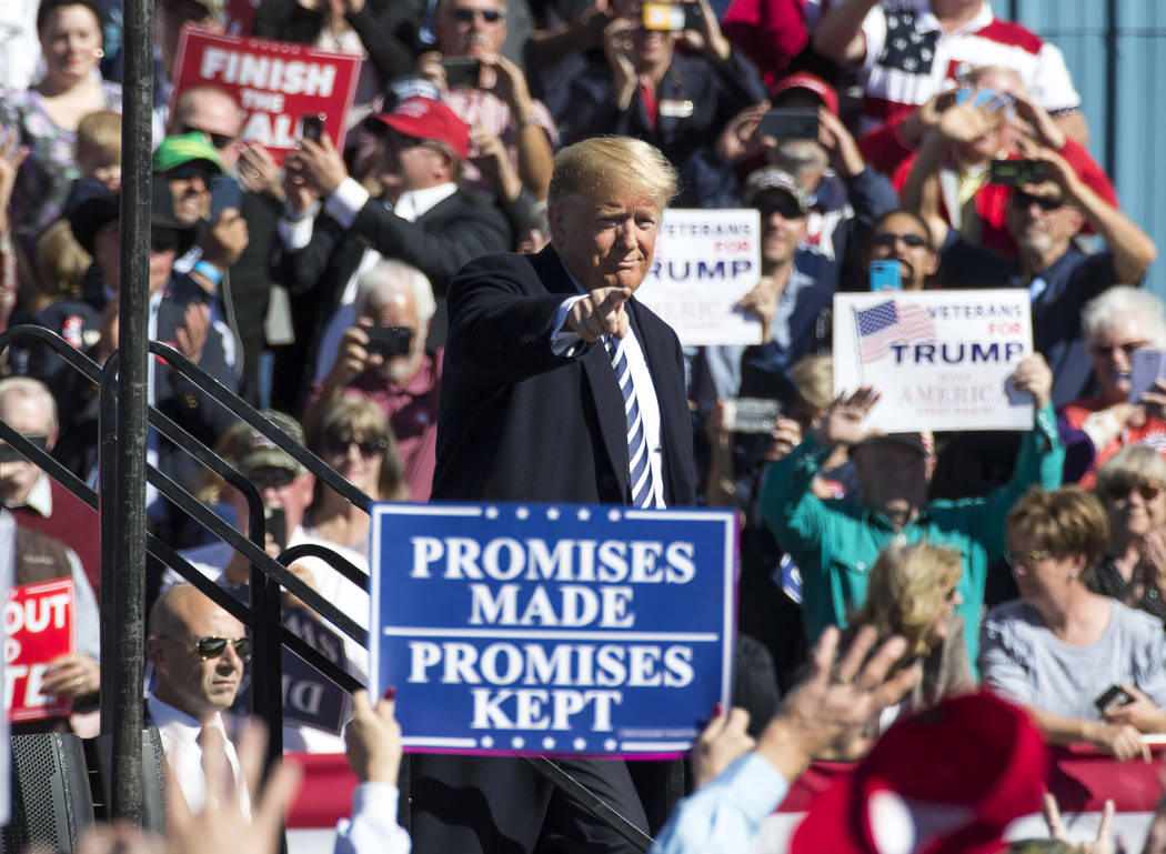 President Donald Trump points to the crowd following a Make America Great Again Rally in Elko, Nev., on Saturday, Oct. 20, 2018. Richard Brian Las Vegas Review-Journal @vegasphotograph