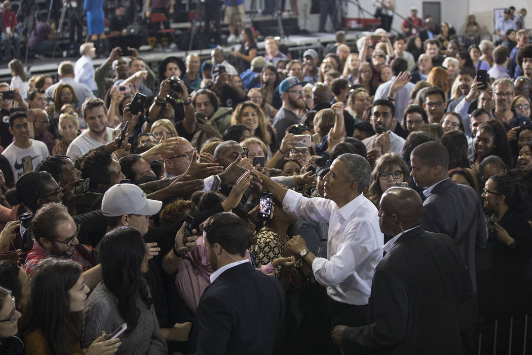 Former President Barack Obama, right, shakes hands with the crowd at Cox Pavilion after a rally on Monday, Oct. 22, 2018, in Las Vegas. Benjamin Hager Las Vegas Review-Journal