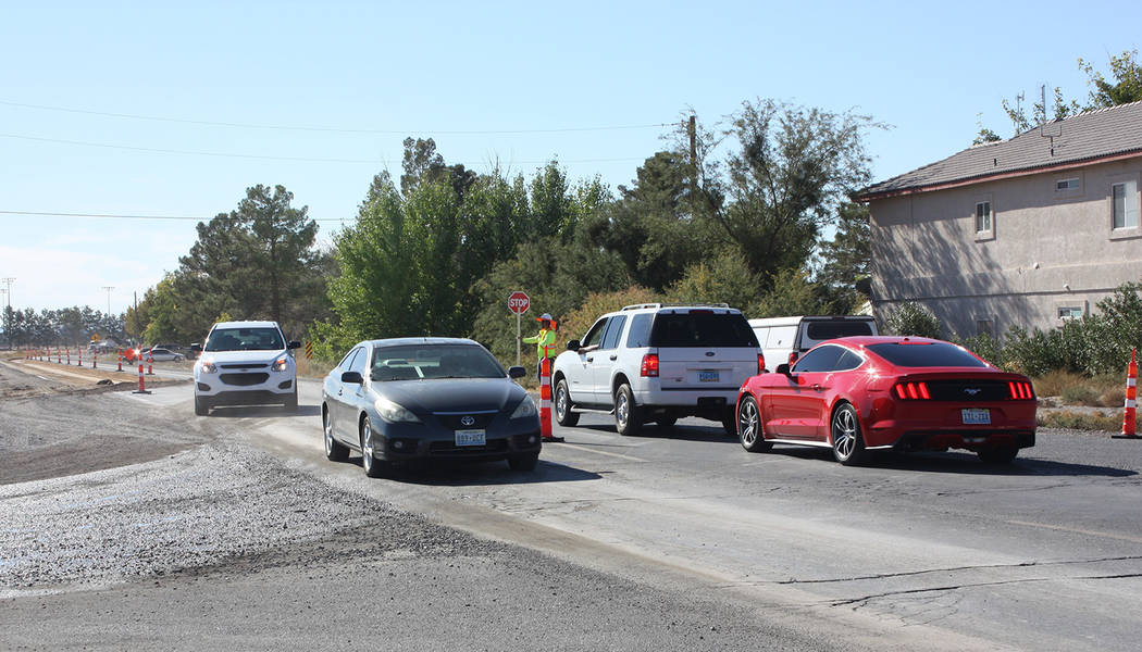 Robin Hebrock/Pahrump Valley Times Vehicles traveling southbound on Pahrump Valley Boulevard wait while flaggers allow traffic moving northbound to access the single open lane.