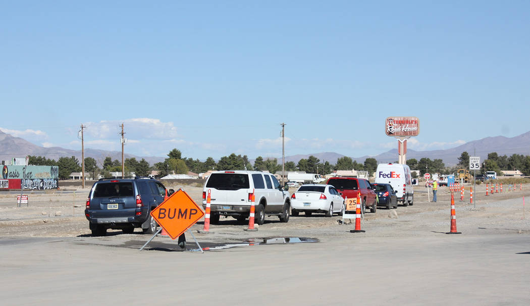 Robin Hebrock/Pahrump Valley Times A line of cars heading north on Pahrump valley Boulevard between Calvada Boulevard and Highway 372 waits for the flagger to motion them to proceed in this photo, ...