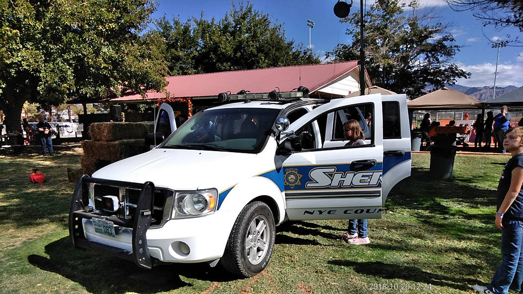Selwyn Harris/Pahrump Valley Times A marked Nye County Sheriff's Office vehicle was also on display for the kids to inspect.