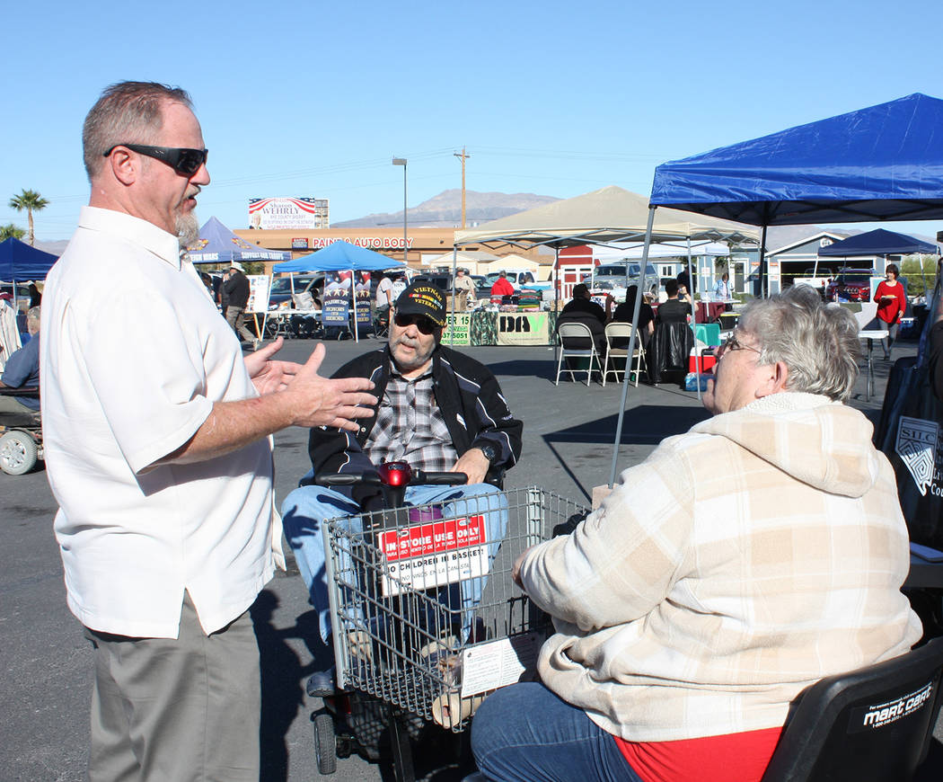Robin Hebrock/Pahrump Valley Times Veterans Stand Down event organizer Linda Wright, at right, is shown conversing with stand down attendees and volunteers on October 19.