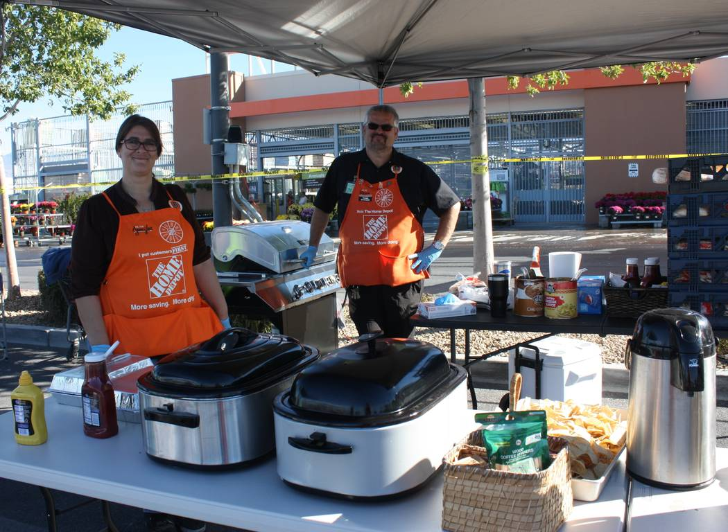 Robin Hebrock/Pahrump Valley Times Two Home Depot team members helped ensure no veteran went hungry at the Veterans Stand Down, grilling hot dogs and laddeling out chili and cheese covered chips.