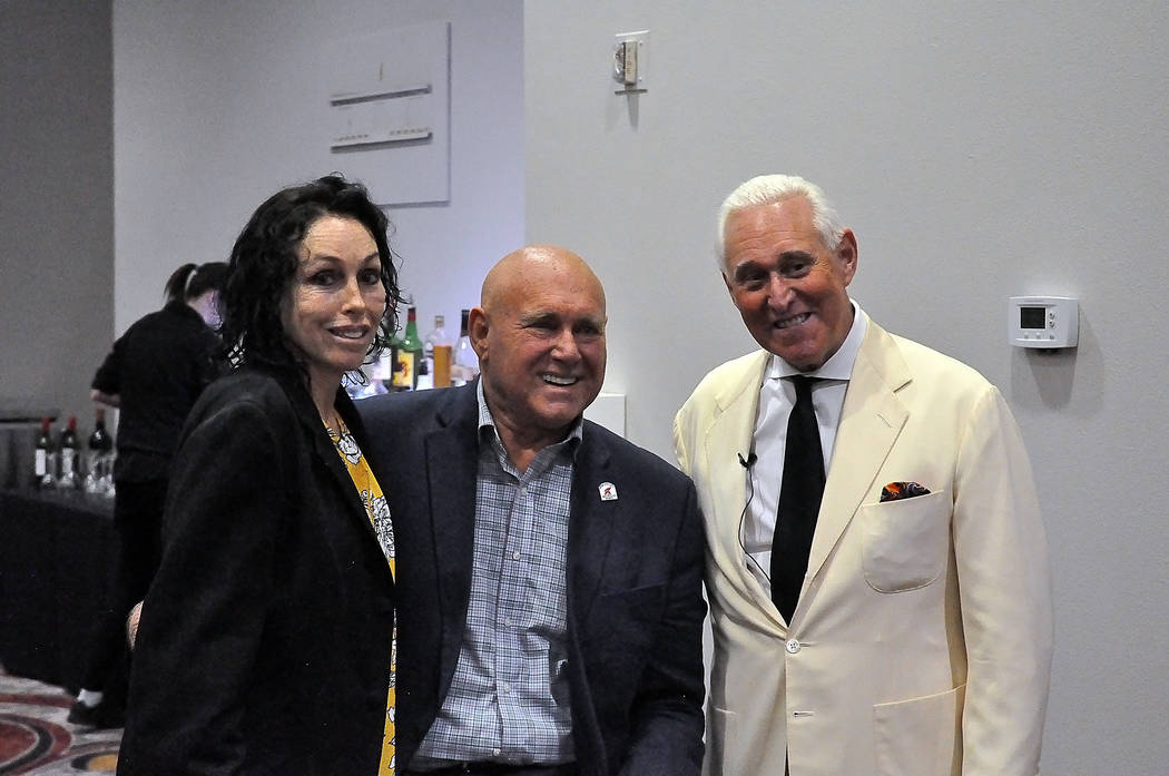 Horace Langford Jr./Pahrump Valley Times Heidi Fleiss (left) stands next to Dennis Hof (center) and Roger Stone (right), longtime confidant of President Donald Trump during a campaign rally for Ho ...