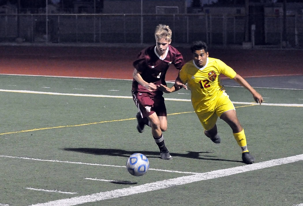 Horace Langford Jr./Pahrump Valley Times Sophomore Vincent DiBlasi battles a Del Sol player for possession Thursday night. Pahrump Valley's 2-1 win over the Dragons clinched a regional playoff ber ...