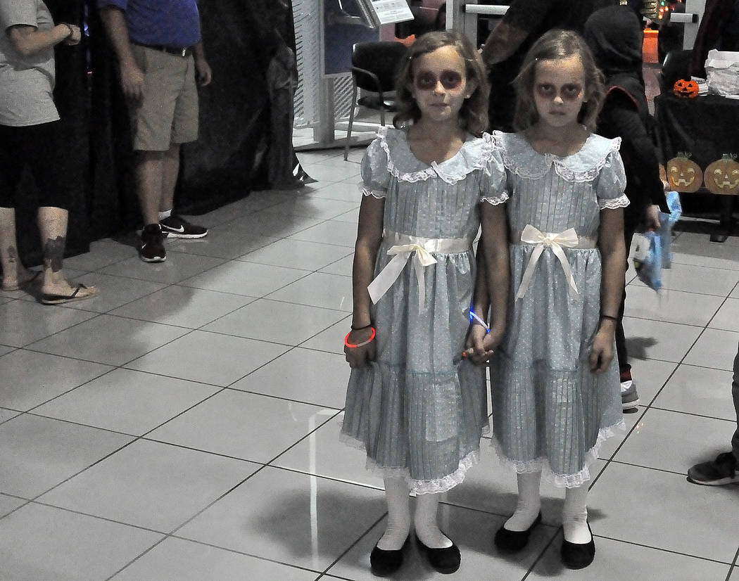 Horace Langford Jr./Special to the Pahrump Valley Times Emily and Madison Burton as Lisa and Louisa dress as the Shining twins. The twins made their way to Pahrump Valley Auto Plaza's Trunk or Tre ...