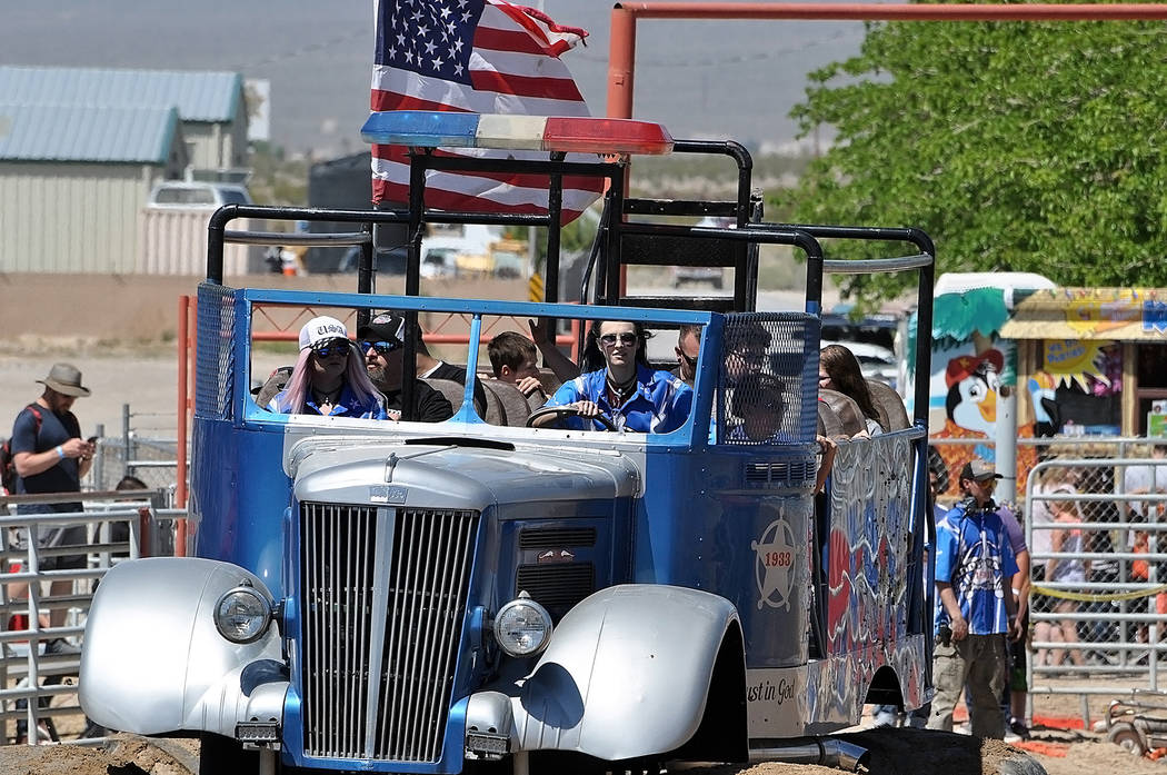 """Horace Langford Jr./Pahrump Valley Times Monster truck fans are treated to a ride in the """"Paddy Wagon"""" April 21 during the Monster Truck Insanity Tour's stop at McCullough Arena in Pahrump."""