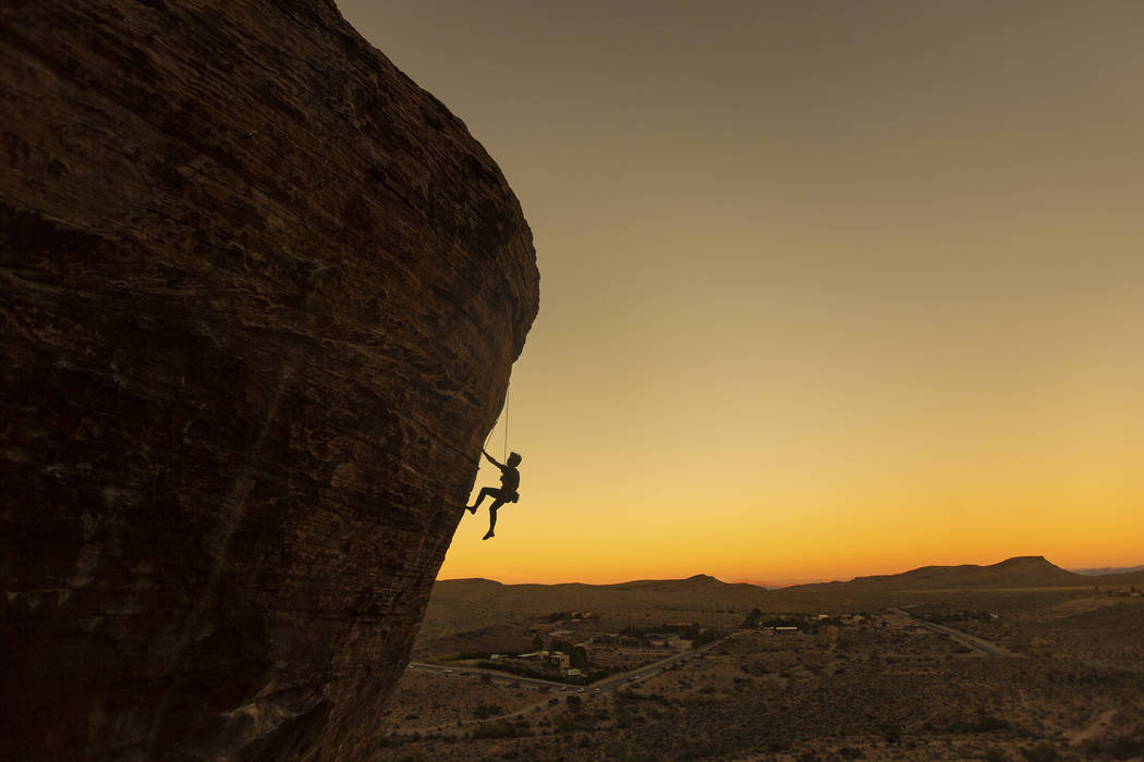 Forrest Chong, from Olympic Valley, Calif., ascends Cannibal Crag at dusk on Wednesday, Oct. 17, 2018, at Red Rock Canyon National Conservation Area, in Las Vegas. Benjamin Hager Las Vegas Review- ...