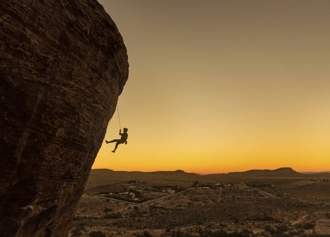 Forrest Chong, from Olympic Valley, Calif., descends Cannibal Crag at dusk on Wednesday, Oct. 17, 2018, at Red Rock Canyon National Conservation Area, in Las Vegas. Benjamin Hager Las Vegas Review ...