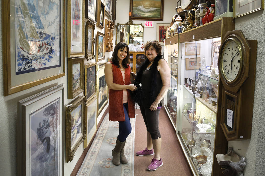 Bizuayehu Tesfaye/Las Vegas Review-Journal Renee Poole, right, and her daughter Jessica, owners of Not Just Antiques Mart, pose for photo at their Antiques Mart on Monday, Oct. 8, 2018, in Las Vegas.