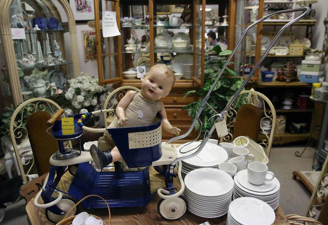 Bizuayehu Tesfaye/Las Vegas Review-Journal Various items, including the 1950's baby stroller are displayed at Not Just Antiques Mart on Wednesday, Oct. 24, 2018, in Las Vegas.