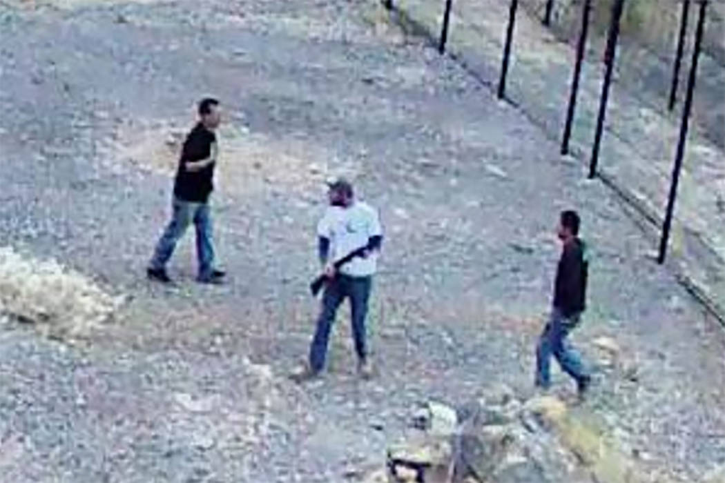 National Park Service Surveillance footage shows three men, at least one with a gun, who broke into the endangered fish habitat at Devils Hole, 90 miles west of Las Vegas, on April 30.