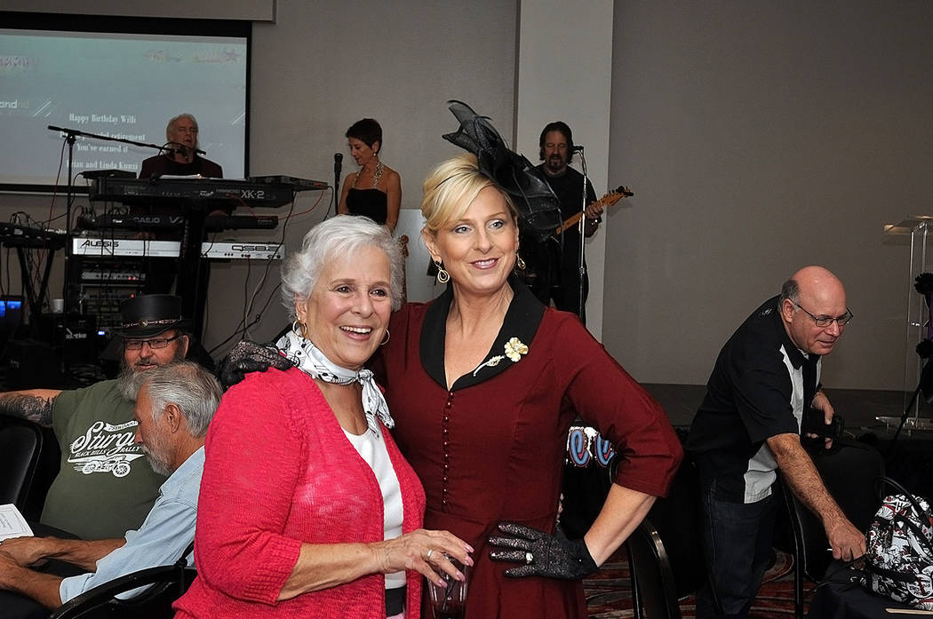 Horace Langford Jr./Pahrump Valley Times Willi Baer (left) and Ronda Van Winkle (right) strike a pose during Baer's retirement party hosted at the Pahrump Nugget.