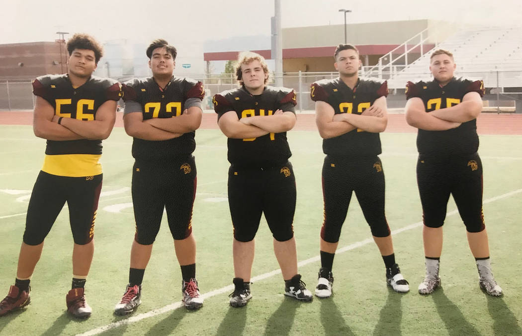 Joe Clayton/Special to the Pahrump Valley Times Pahrump Valley High School linemen Brandon Bunker, Armani McGhee, Jakob Landis, Caleb Sproul and Zach Trieb after practice Oct. 30 at Trojan Field.