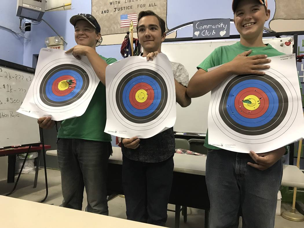 Jeffrey Meehan/Pahrump Valley Times Garrette Domina (left), Sabastian Fronk (center) and Augustes Domina (right) stand with their targets from the University of Nevada Cooperative Extensions 2018 ...