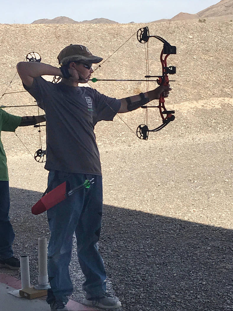 Special to the Pahrump Valley Times Augustes Domina lines up his shot at the target range at Pahrump 4-H's Annex building at 1651 E. Calvada Blvd.