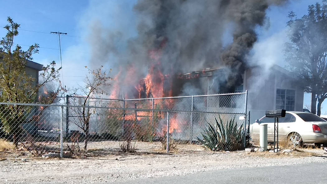 Selwyn Harris/Pahrump Valley Times An early Wednesday afternoon fire destroyed a double-wide manufactured home along the 900 block of Firebird Circle West. All three occupants managed to escape wi ...