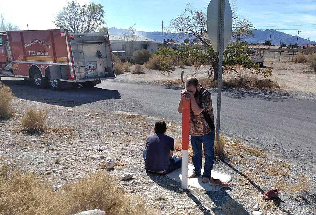 Selwyn Harris/Pahrump Valley Times Michael Neal Ramsey, standing, is in disbelief after fire destroyed his home of more than five years. Ramsey and roommate, Robert Hommel had less than a minute t ...