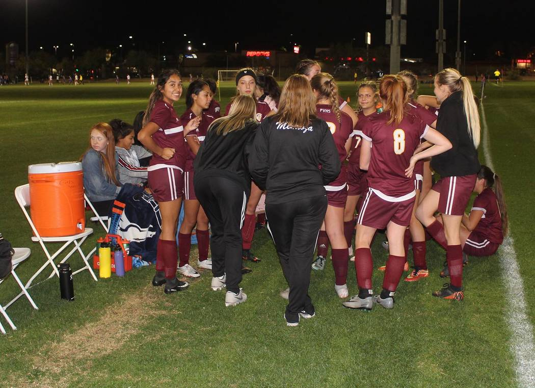 Tom Rysinski/Pahrump Valley Times Pahrump Valley High School girls soccer coach Julie Carrinton addresses her team at halftime of the Trojans' 1-0 win over Moapa Valley on Wednesday night at the B ...