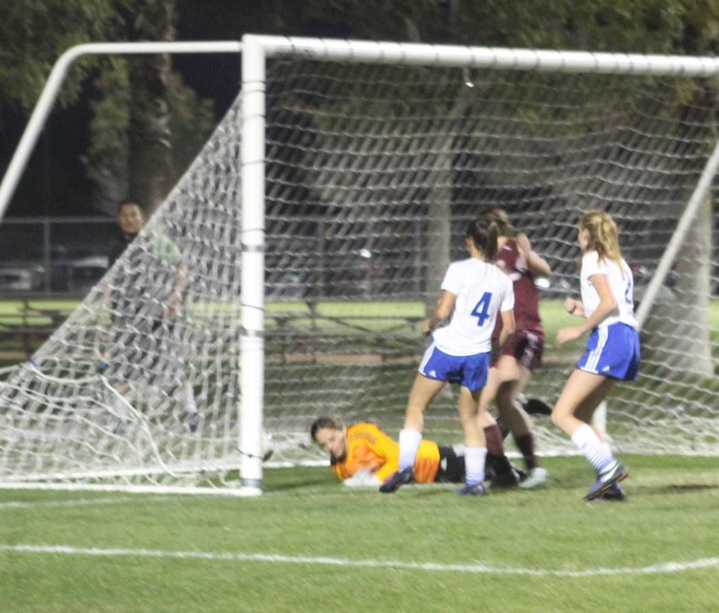Tom Rysinski/Pahrump Valley Times Halie Souza sends the ball past a diving Moapa Valley goalkeeper Kyra Larsen for the only goal of Pahrump Valley's 1-0 victory Wednesday night in the Class 3A Sou ...