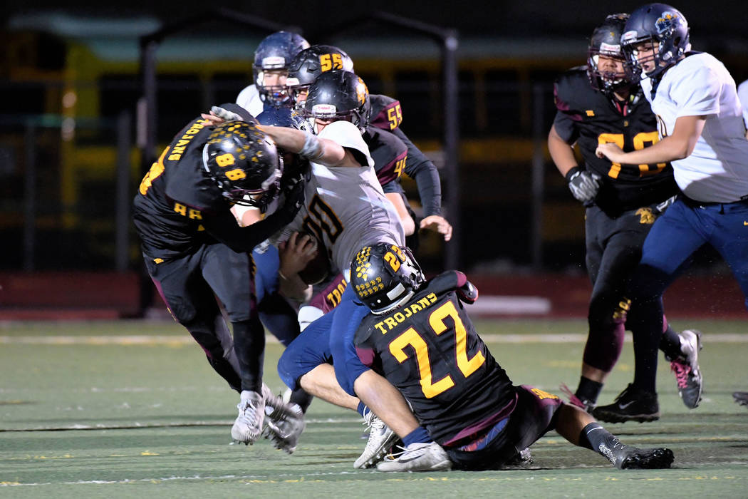 Peter Davis/Special to the Pahrump Valley Times Tony Margiotta (88), Anthony Peralta (22) and Tristan Maughan (45) of Pahrump Valley converge on Boulder City's Thorsten Balmer during their Class 3 ...