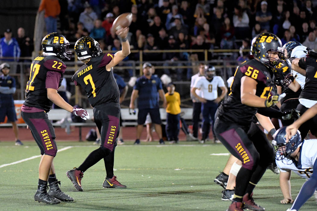 Peter Davis/Special to the Pahrump Valley Times Pahrump Valley quarterback Dylan Wright uncorks a pass against Boulder City while Brandon Bunker (56) provides protection Friday night in Pahrump.