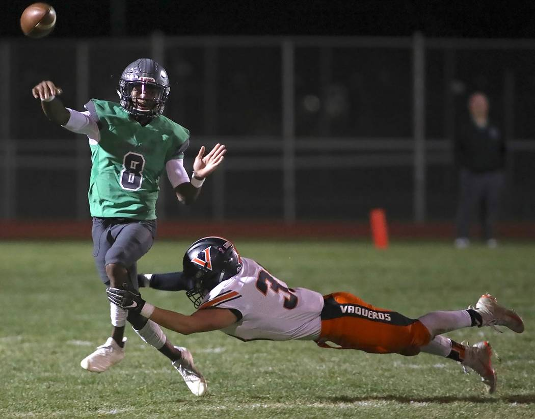 Thomas Ranson/Special to the Pahrump Valley Times Quarterback Elijah Jackson threw for 224 yards and four touchdowns while rushing for 80 yards and a score in Churchill County's 54-13 playoff win ...