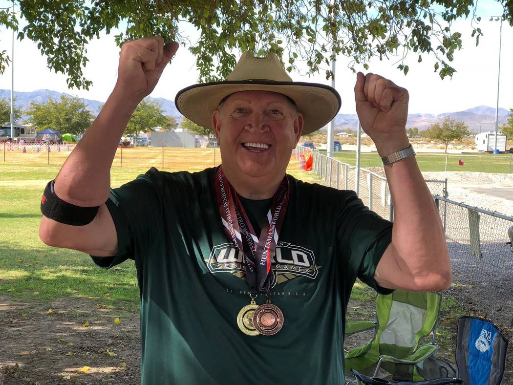 Tom Rysinski/Pahrump Valley Times Pahrump resident Dennis Andersen shows off the gold and bronze medals he won in October at the Huntsman World Senior Games in St. George, Utah.