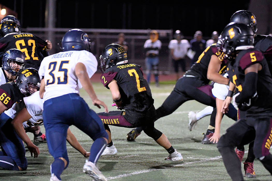 Peter Davis/Special to the Pahrump Valley Times Pahrump Valley senior Joey Koenig finds a hole during the Trojans' 32-30 victory over Boulder City at Trojan Field, their first playoff victory sinc ...
