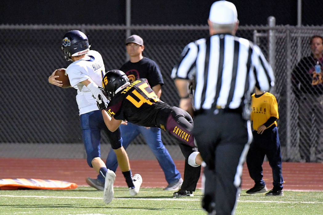 Peter Davis/Special to the Pahrump Valley Times Senior Tristan Maughan makes a flying stop on Boulder City quarterback Parker Reynolds during Pahrump Valley's 32-30 win over the visiting Eagles on ...
