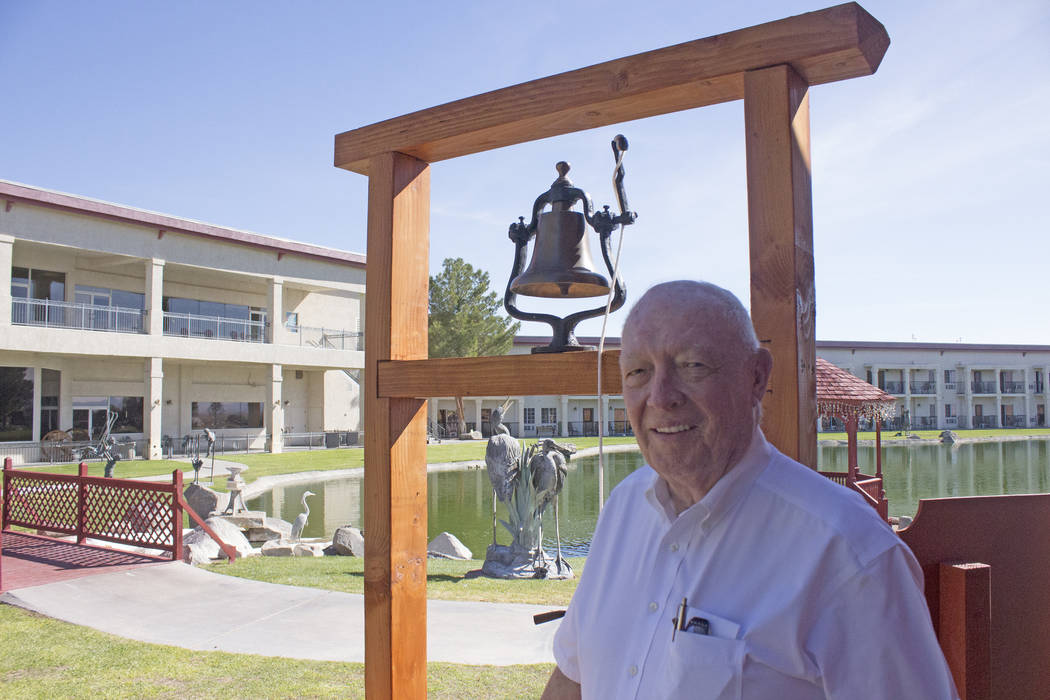 Jeffrey Meehan/Pahrump Valley Times Jim Marsh stands next to the bell of a replica 19th century Catholic church he built at his Longstreet Inn Casino & RV Resort in Amargosa Valley. Marsh recreate ...