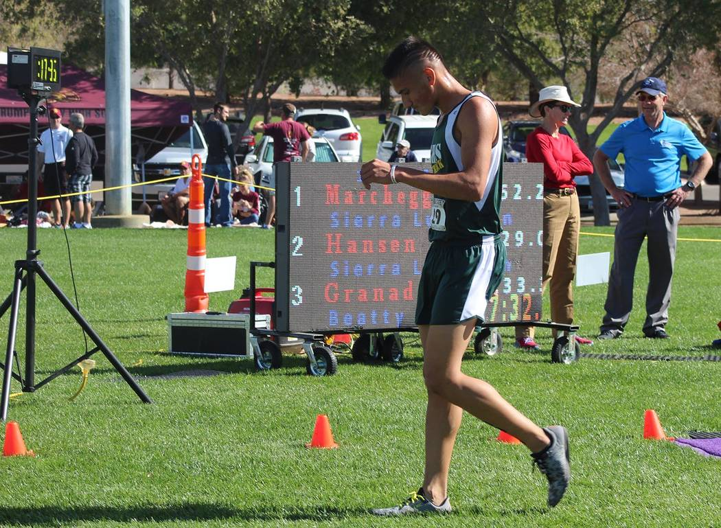 Tom Rysinski/Pahrump Valley Times The board tells the story of Beatty junior Jose Granados' third-place finish in the Class 2A/1A cross country championships on Saturday at Veterans Memorial Park ...