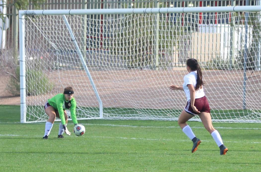 Tom Rysinski/Pahrump Valley Times Pahrump Valley goalkeeper Hannah McElheny gathers in a save during the Trojans' 1-0 win over Western in the Class 3A Southern championship game on Saturday in Las ...