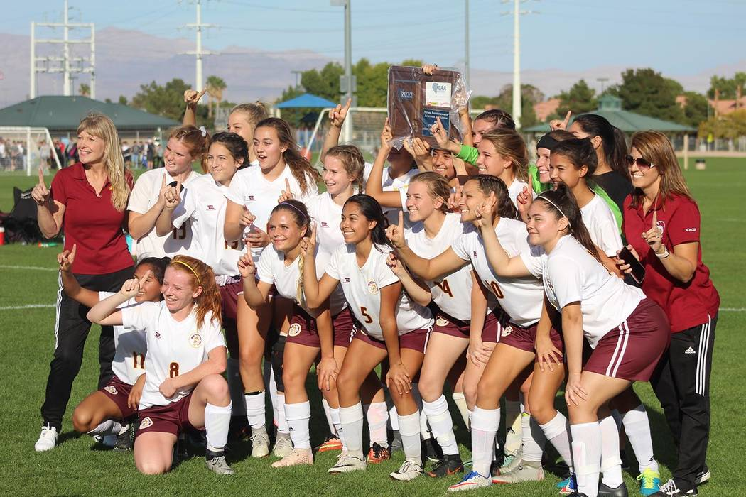 Tom Rysinski/Pahrump Valley Times Pahrump Valley girls soccer players and coaches pose with the Class 3A Southern Region championship trophy after their 1-0 win over Western on Saturday in Las Vegas.