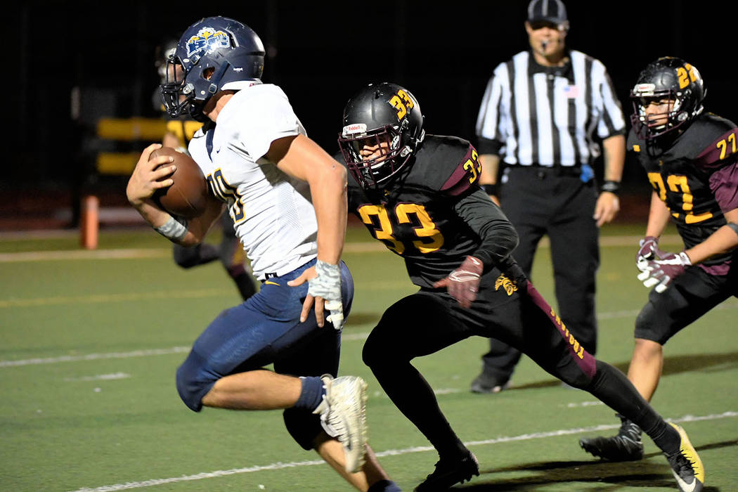 Peter Davis/Special to the Pahrump Valley Times Pahrump Valley's Jalen Denton moves in on Boulder City's Thorsten Balmer during Friday night's Class 3A playoff game at Trojan Field.