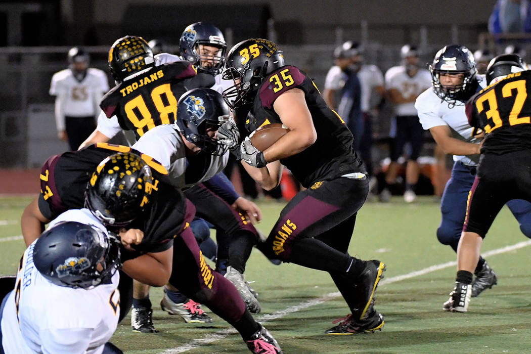 Peter Davis/Special to the Pahrump Valley Times Armani McGhee (73), Antonio Margiotta (88) and Fabian Soriano (32) help clear a path for Nico Velazquez during Pahrump Valley's 32-30 win over Bould ...