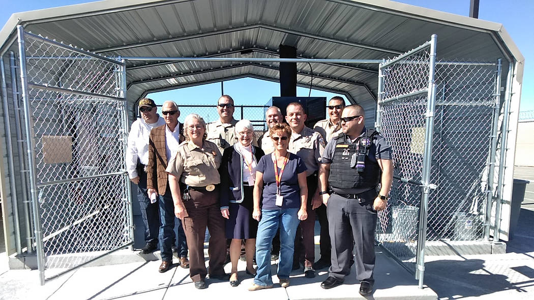 Selwyn Harris/Pahrump Valley Times Nye County Sheriff Sharon Wehrly, front left stands with state and local officials following a special drug burning demonstration at the sheriff's office facilit ...