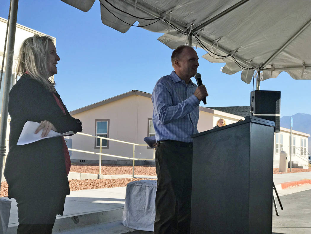 Jeffrey Meehan/Pahrump Valley Times Dr. Edward Harding, lead provider for P3 Medical Group's Pahrump clinic (right) speaks at the group's grand opening celebration on Oct. 30, 2018. Harding is th ...
